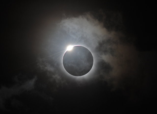 The Diamond Ring effect is shown following totality of the solar eclipse at Palm Cove in Australia's Tropical North Queensland on November 14, 2012. Eclipse-hunters have flocked to Queensland's tropical northeast to watch the region's first total solar eclipse in 1,300 years on November 14, which occurred as the moon passed between the earth and the sun, casting a shadow path on the globe and lasting for a maximum on the Australian mainland of 2 minutes and 5 seconds. (Photo by Greg Wood/AFP Photo)