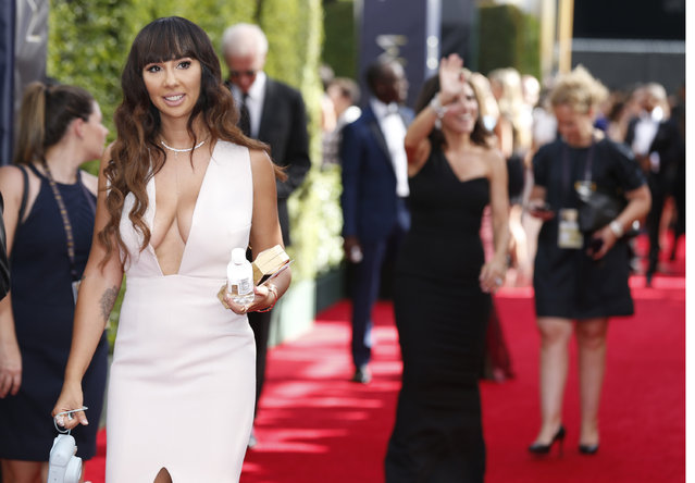 Jackie Cruz arrives at the 67th Primetime Emmy Awards on Sunday, September 20, 2015, at the Microsoft Theater in Los Angeles. (Photo by Eric Jamison/Invision for the Television Academy/AP Images)