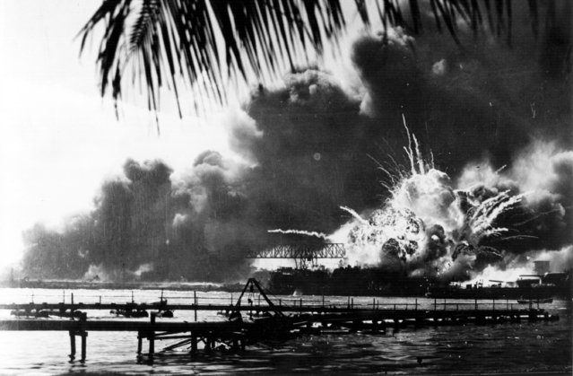 The American destroyer USS Shaw explodes during the Japanese attack on Pearl Harbour (Pearl Harbor), home of the American Pacific Fleet during World War II.   (Photo by Keystone/Getty Images)