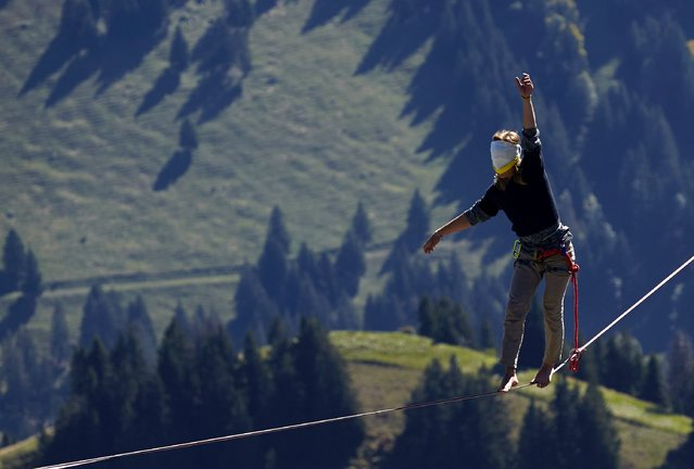 Oliver Ross of Austria walks blindfolded on the line during the Highline Extreme event in Moleson, Switzerland September 25, 2015. (Photo by Denis Balibouse/Reuters)