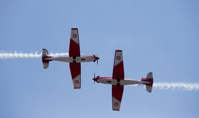 The Swiss Air Force PC-7 Team, flying Pilatus PC-7 Turbo Trainer aircrafts, take part in a display during the Malta International Airshow at Malta International Airport, outside Valletta, Malta, September 27, 2015. (Photo by Darrin Zammit Lupi/Reuters)