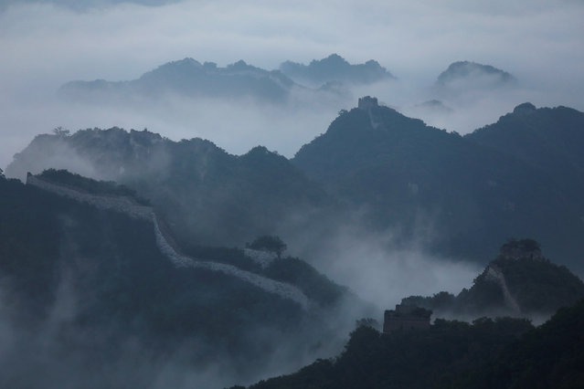 Early morning fog covers the Jiankou section of the Great Wall, located in Huairou District, north of Beijing, China, June 7, 2017. (Photo by Damir Sagolj/Reuters)