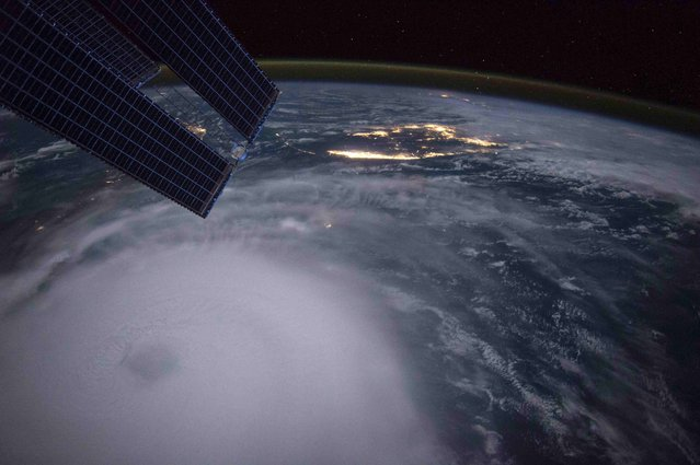 Hurricane Joaquin is seen over the Bahamas in this handout photo provided by NASA and taken by Astronaut Scott Kelly from the International Space Station, September 2, 2015. The Category-4 storm pounded the Bahamas for a second day with powerful winds and waves on Friday, but it was not expected to be a major threat to the U.S. east coast, the National Hurricane Center said. (Photo by Scott Kelly/Reuters/NASA)