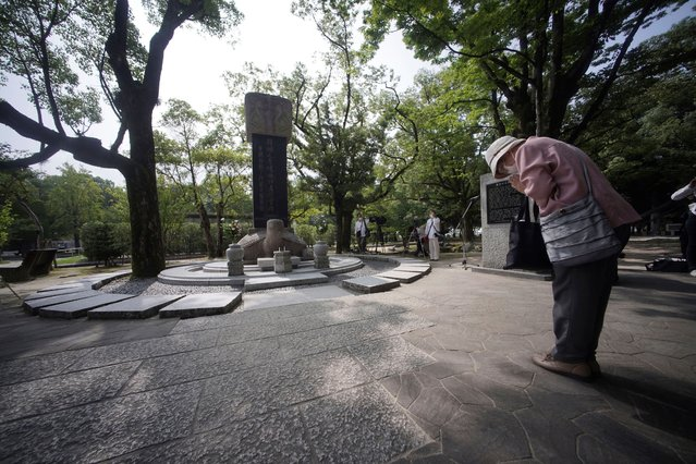 A woman prays before a memorial service for Korean atomic bomb victims in front of Monument to Korean Victims and Survivors at Hiroshima Peace Memorial Park in Hiroshima, western Japan, Wednesday, August 5, 2020. Hiroshima marks the 75th anniversary of the world's first atomic bombing on Aug. 6. (Photo by Eugene Hoshiko/AP Photo)