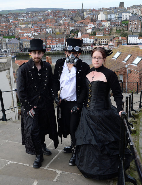 "People make their way up the 199 steps during the ""Whitby Goth Weekend"", North Yorkshire, on November 2, 2014. (Photo by Anna Gowthorpe/PA Wire)"