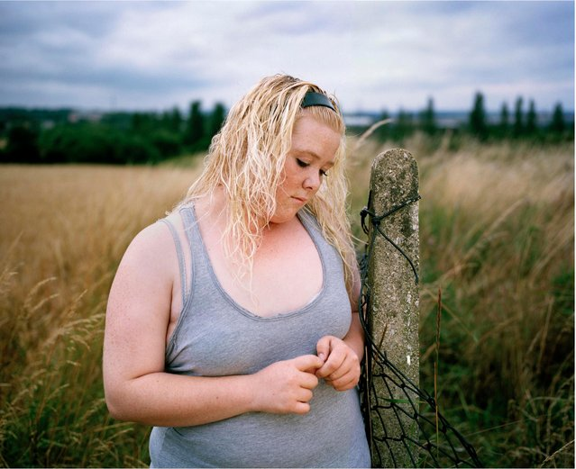 """A girl named only as Chelsea at a charity for obese youngsters"". Taylor Wessing photographic portrait prize 2010. (Photo by Abbie Trayler-Smith)"