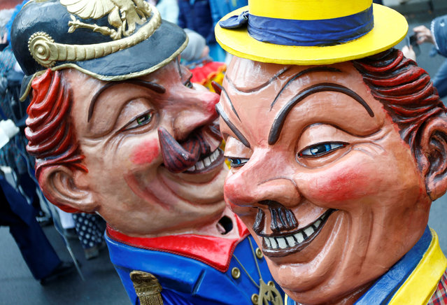 """Carnival revellers at the traditional """"Rosenmontag"""" Rose Monday carnival parade in in Mainz, Germany on February 12, 2018. (Photo by Ralph Orlowski/Reuters)"""