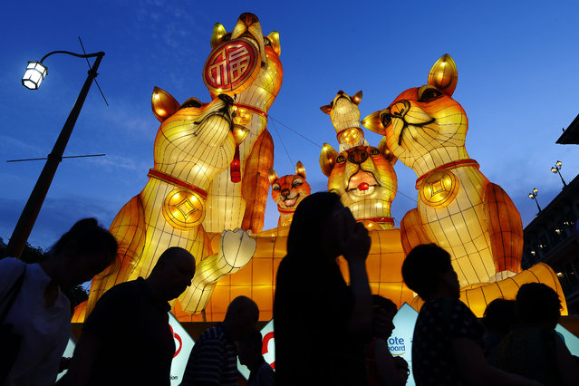 Giant dog lanterns loom over the road at at Chinatown on February 14, 2018 in Singapore. On February 16, people around the world will welcome the Year of the Dog, one of the most anticipated holidays on the Chinese calendar. Also known as the Spring festival or the Lunar New Year, the celebrations last for about 15 days. (Photo by Suhaimi Abdullah/Getty Images)