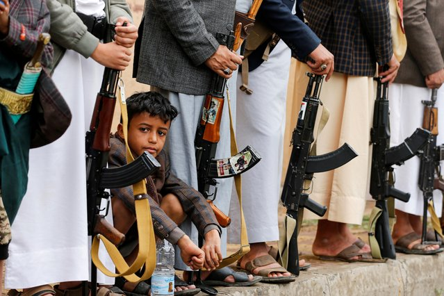 A boy sits among Houthi followers during a Houthi gathering in Sanaa, Yemen on July 6, 2020. (Photo by Khaled Abdullah/Reuters)