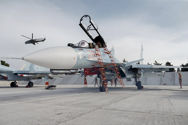 A Sukhoi Su-30 fighter jet is seen on the tarmac at the Hmeymim air base near Latakia, Syria, in this handout photograph released by Russia's Defence Ministry on October 22, 2015. (Photo by Reuters/Ministry of Defence of the Russian Federation)