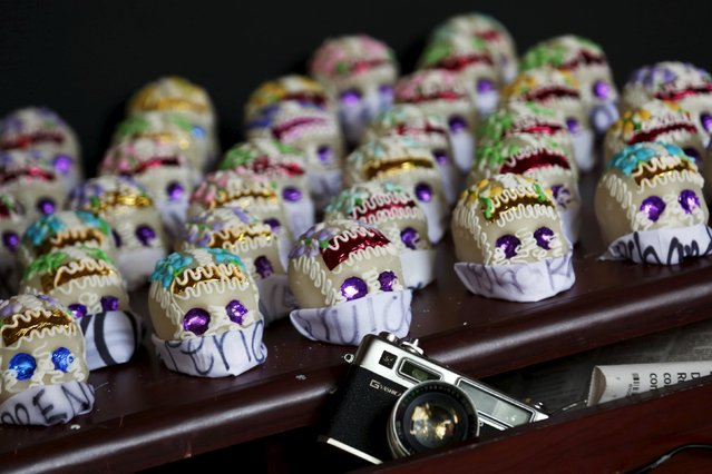 Sugar skulls with journalists' names are seen as part of an altar for Day of the Dead in memory of Mexico's killed and disappeared journalists at the Memory and Tolerance Museum in Mexico City October 29, 2015. According to Linda Atach, director of expositions at the museum, the altar is displayed to remember the 89 journalists who have been killed between 2005 and 2015 in the country. (Photo by Carlos Jasso/Reuters)
