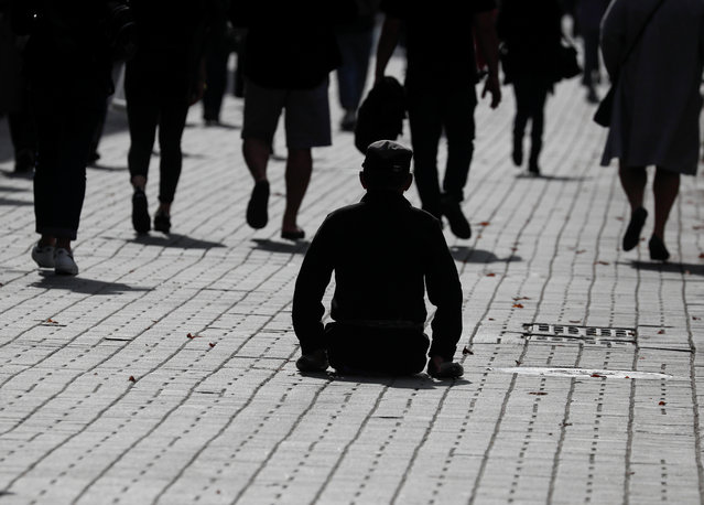 A  man with physical disabilities is seen in central Kyiv, Ukraine on October 9, 2020. (Photo by Gleb Garanich/Reuters)