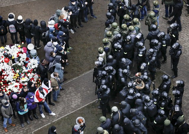 Belarusian riot police block demonstrators gather to honor 31-year-old Raman Bandarenka, who died Thursday at a Minsk hospital after several hours of surgery due to serious injuries, during an opposition rally to protest the official presidential election results in Minsk, Belarus, Sunday, November 15, 2020. Protests have rocked Belarus since the August election that official results say gave Lukashenko a sixth term in office but that opponents and some polls workers claim were manipulated. (Photo by AP Photo/Stringer)