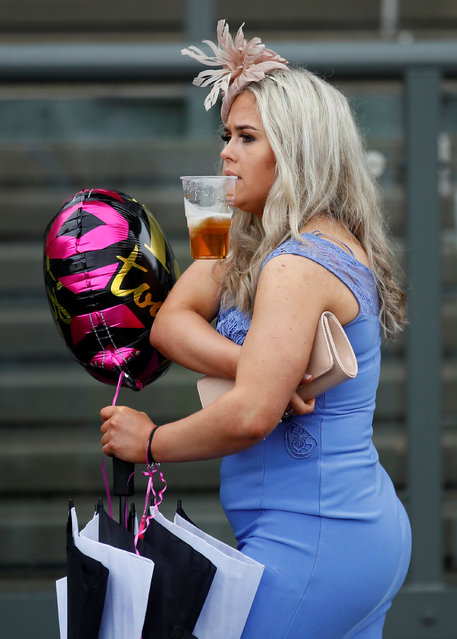 A racegoer during Ladies Day at the Grand National Festival at Aintree Racecourse on April 13, 2018 in Liverpool, England. (Photo by Jason Cairnduff/Reuters/Action Images)