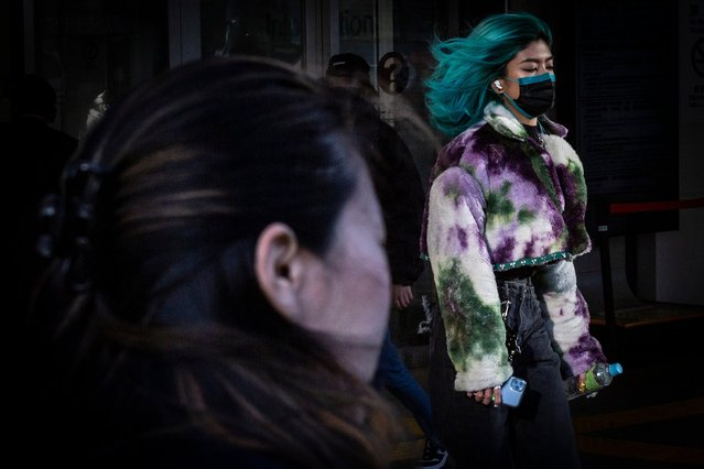 A woman wearing a face mask walk through Shinjuku area on January 07, 2021 in Tokyo, Japan. Japanese Prime Minister Yoshihide Suga is set to declare a state of emergency in Tokyo and neighboring three prefectures, Kanagawa, Saitama, and Chiba on Thursday, following the recent surge in COVID-19 cases in the region. Tokyo saw over 2000 new cases per day for the first time on January 7, 2021. (Photo by Yuichi Yamazaki/Getty Images)