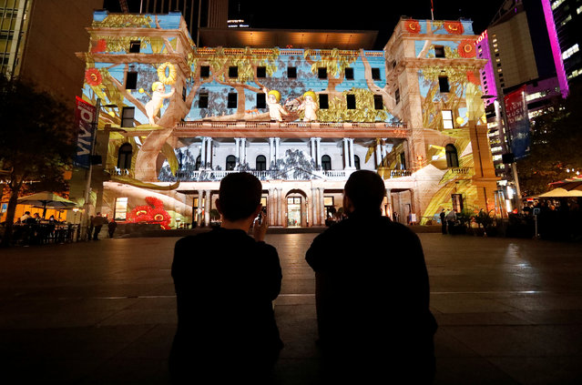Crowds look at projections of Australian cartoon characters on the walls of the historical Customs House, during the official start of Vivid Sydney, promoted as the world's largest festival of light, music and ideas, in Sydney, Australia, May 25, 2018. The festival will run for 23 days. (Photo by David Gray/Reuters)