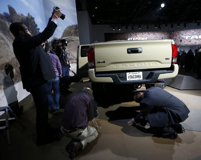 Members of the media look over a 2016 Toyota Tacoma pickup truck after it was unveiled during the first press preview day of the North American International Auto Show in Detroit, Michigan, January 12, 2015. (Photo by Mark Blinch/Reuters)