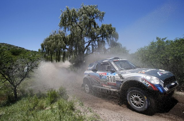 Mini driver Vladimir Vasilyev of Russia drives during the 12th stage of the Dakar Rally 2015 from Termas de Rio Hondo to Rosario January 16, 2015. (Photo by Jean-Paul Pelissier/Reuters)