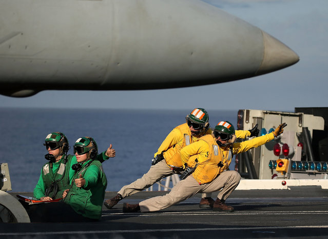 A flight deck crew prepares to launch a F18 Super Hornet from the deck of the USS Eisenhower off the coast of Virginia, December 10, 2015 in the Atlantic Ocean. US Defense Secretary Ash Carter visited the carrier with India's Minister of Defense Manohar Parrikar to demonstrate US Navy aircraft carrier flight operations. (Photo by Mark Wilson/Getty Images)