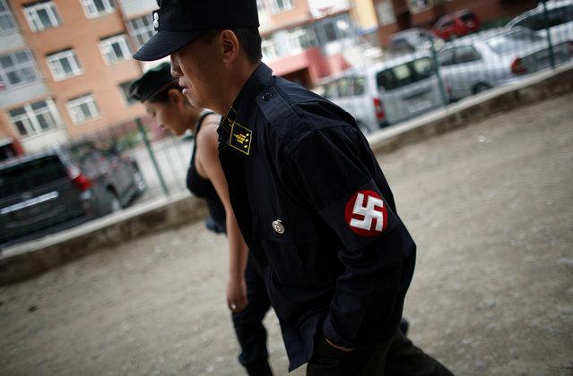Members of Mongolian neo-Nazi group Tsagaan Khass walk along a street in Ulan Bator, on June 22, 2013. (Photo by Carlos Barria/Reuters)