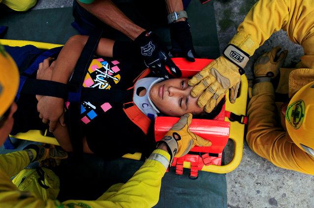 Members of the rescue unit participate in a practice session at the Comandos de Salvamento base in San Salvador, El Salvador July 2, 2016. (Photo by Jose Cabezas/Reuters)