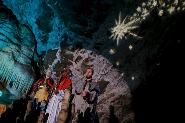 Actors perform the living Nativity biblical scenes in Postojna cave in Postojna, Slovenia, December 22, 2015. (Photo by Srdjan Zivulovic/Reuters)