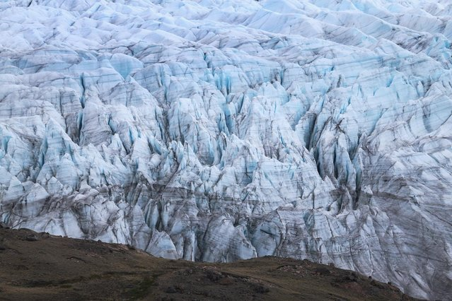 A glacier is seen on July 13, 2013 in Kangerlussuaq, Greenland. (Photo by Joe Raedle/Getty Images via The Atlantic)