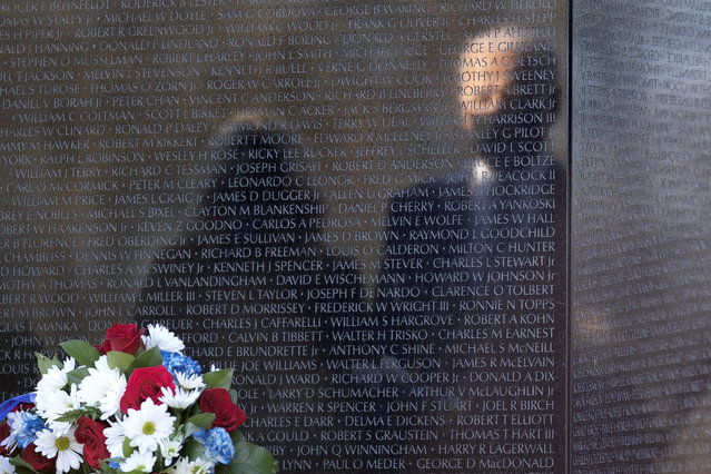 US President Joe Biden and First Lady Dr. Jill Biden are reflected in the Vietnam War Memorial as they visit in Washington, DC, USA on 29 March 2021 to pay their respects on National Vietnam War Veterans Day. (Photo by Stefani Reynolds/Pool/EPA/EFE/Rex Features/Shutterstock)