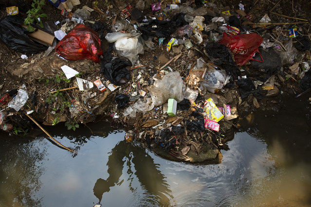 Plastic trash lies by the side of a small stream which drains into the Citarum River August 28, 2018 outside Majalaya, Java, Indonesia. (Photo by Ed Wray/Getty Images)