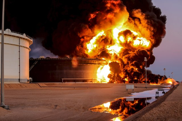 Fire rises from an oil tank in the port of Es Sider, in Ras Lanuf, Libya January 4, 2016. (Photo by Reuters/Stringer)