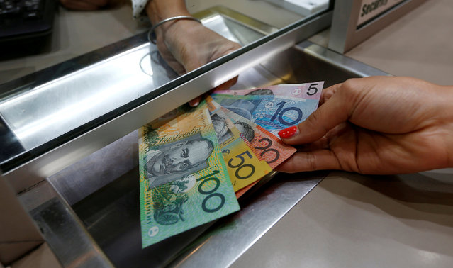 Australian dollar denominations shown in a photo illustration at a currency exchange in Sydney, Australia, June 7, 2016. (Photo by Jason Reed/Reuters)