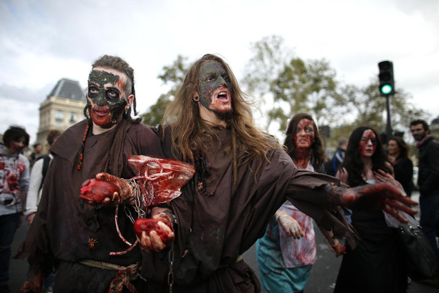 Two men dressed as zombies participate in a Zombie Walk procession in the streets of Paris October 12, 2013. (Photo by Benoit Tessier/Reuters)