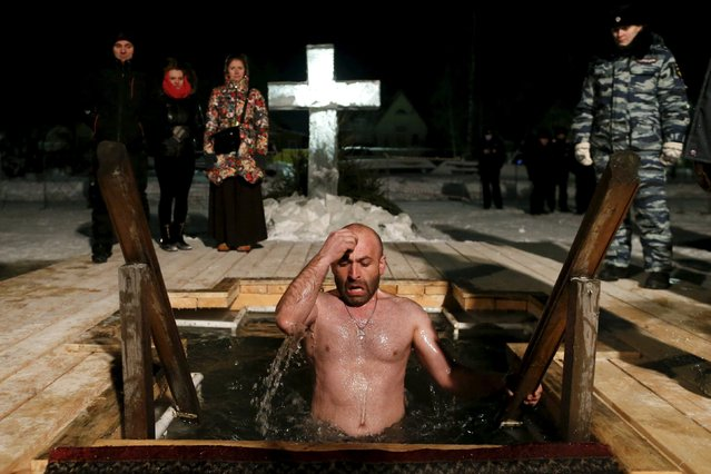 A man jumps into icy water during Epiphany celebration in the historic town of Pereslavl Zalessky, some 150 km (93 miles) from Moscow, January 19, 2016. (Photo by Maxim Zmeyev/Reuters)