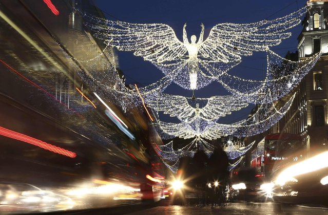 Christmas lights are seen illuminated on Regent Street in London, Britain December 3, 2016. (Photo by Neil Hall/Reuters)