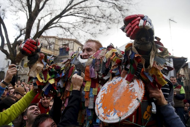 Armando Vicente Vicente, 30, celebrates with revellers after enduring getting hit by turnips during the Jarramplas traditional festival in Piornal, southwestern Spain, January 20, 2016. (Photo by Susana Vera/Reuters)