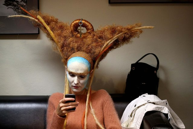 A model waits to be styled by the Dmitry Vinokurov team before performing at the ENIGMA Alternative Hair Show in the Royal Albert Hall in London, on Oktober 13, 2013. The show is one of the world's most prestigious hairdressing events, bringing together international teams of hair artists to showcase groundbreaking hair styling. (Photo by Oli Scarff/Getty Images)