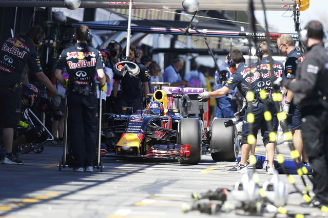 Red Bull Formula One driver Daniil Kvyat of Russia sits in the pit lane during the first practice session of the Australian F1 Grand Prix at the Albert Park circuit in Melbourne March 13, 2015. REUTERS/Brandon Malone