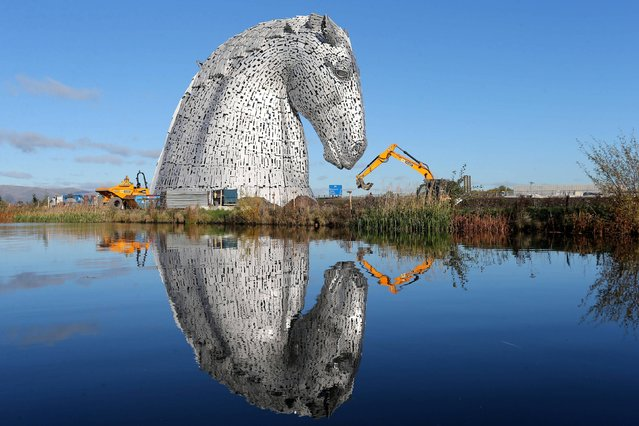Work nears completion on The Kelpies, a public art and visitor attraction created by artist Andy Scott, which form a gateway to the Forth and Clyde canal at the Helix, Falkirk, Scotland, on November 4, 2013. (Photo by Andrew Milligan/PA Wire)