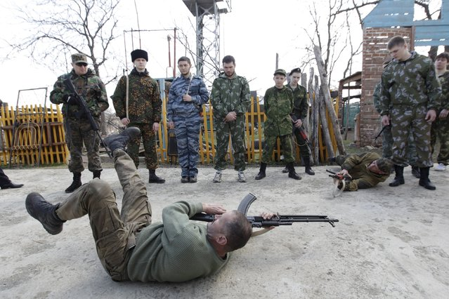 Members of the local Cossack community undergo military training at a boot camp set up by the Russkiye Vityazi (Russian Knights) military patriotic club in the village of Sengileyevskoye, south of Stavropol, March 22, 2015. (Photo by Eduard Korniyenko/Reuters)