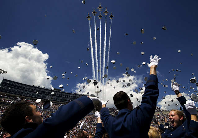The U.S. Air Force Thunderbirds fly the Delta formation over Falcon Stadium during the U.S. Air Force Academy Graduation Ceremony, May 28, 2014. The flyover marks the return of the Thunderbirds to Colorado Springs since sequestration last year. (Photo by Staff Sgt. Larry E. Reid Jr./U.S. Air Force)