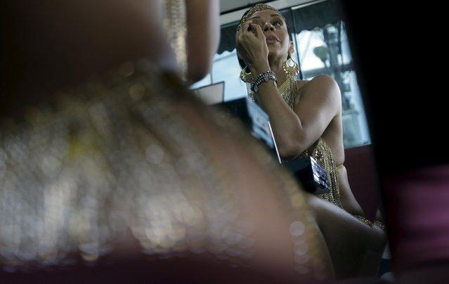 Larissa Neto, a muse of the Unidos da Tijuca Samba School, puts on make up as she wears a carnival dress in Sao Goncalo near Rio de Janeiro, Brazil, February 3, 2016. (Photo by Ricardo Moraes/Reuters)
