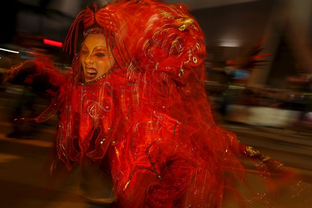 A performer from Stelzen-Art & Confusao in Germany takes part in a Lunar New Year parade in Hong Kong, China February 8, 2016 to celebrate the first day of the Lunar New Year of the Monkey. (Photo by Bobby Yip/Reuters)