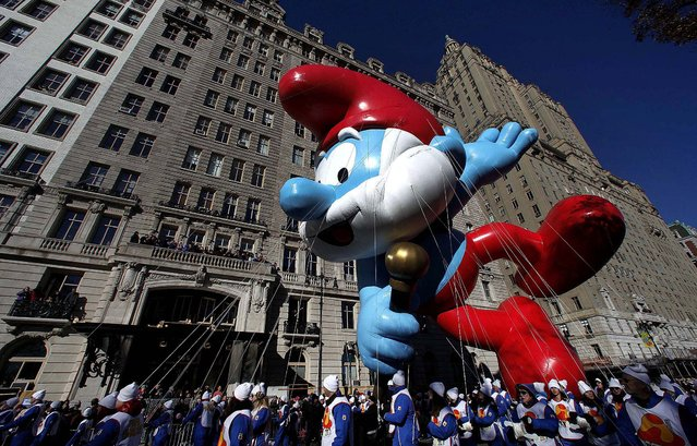 The Papa Smurf balloon floats down Central Park West. (Photo by Gary Hershorn/Reuters)