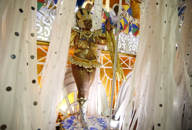 A reveller of Vila Isabel samba school performs during the carnival parade at the Sambadrome in Rio de Janeiro February 8, 2016. (Photo by Pilar Olivares/Reuters)