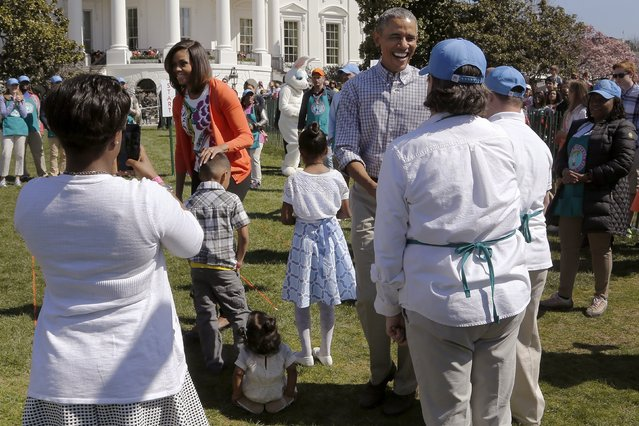 U.S. President Barack Obama (R) and first lady Michelle Obama (L) greet children and volunteers during the annual Easter Egg Roll at the White House in Washington April 6, 2015. (Photo by Jonathan Ernst/Reuters)