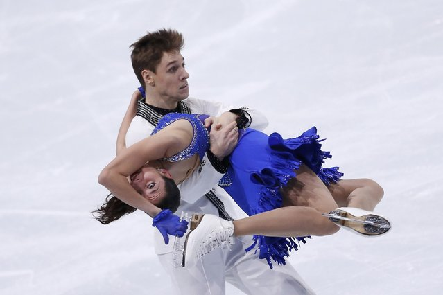 Ksenia Monko and Kirill Khaliavin of Russia perform during their ice dance short program at the ISU Bompard Trophy event at Bercy in Paris, November 15, 2013. (Photo by Gonzalo Fuentes/Reuters)