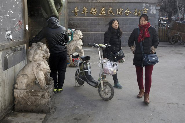 Chinese women walk out from a local market in Beijing, China, Sunday, January 8, 2017. Residents enjoyed the reprieve after a weeklong smog alert as clean air returned to the Chinese capital. (Photo by Ng Han Guan/AP Photo)