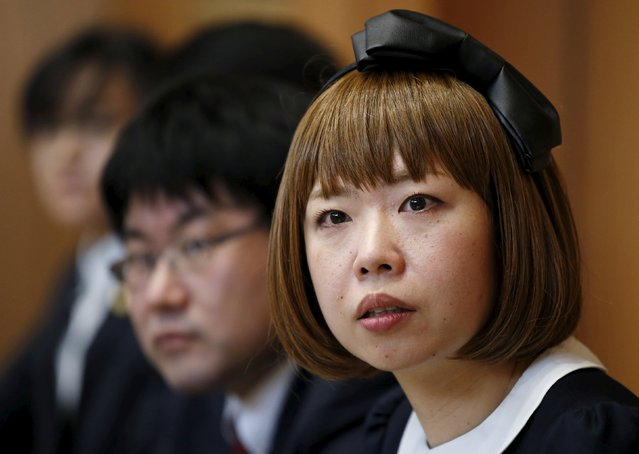 Japanese artist Megumi Igarashi (R), known as Rokudenashiko, attends a news conference with lawyers following a court appearance in Tokyo April 15, 2015. (Photo by Toru Hanai/Reuters)
