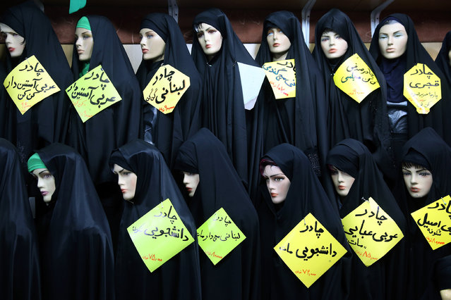 Mannequins wearing black veils stand in an inside shop in south of Tehran, Iran, Thursday, February 25, 2016. (Photo by Ebrahim Noroozi/AP Photo)