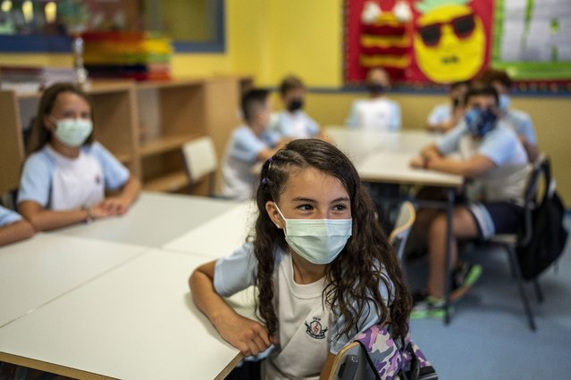 Pupils wearing a face mask to protect against the spread of coronavirus attend a class at Maestro Padilla school as the new school year begins, in Madrid, Spain, Tuesday, September 7, 2021. Around 8 million children in Spain are set to start the new school year. (Photo by Manu Fernandez/AP Photo)